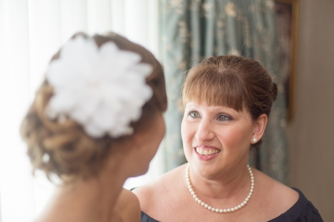 A loving mother looks into the eyes of her daughter on her daughter's wedding day.