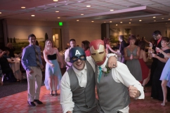 The groom and his best man sport their favorite superhero outfits while they have some fun on the dance floor during their superhero themed New England wedding