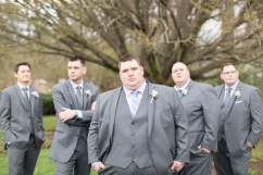 The groom poses with his groomsmen underneath a beautiful tree at Elizabeth Park Rose Garden in West Hartford, Connecticut
