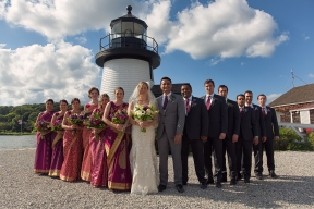 The bridal party poses in front of the Mystic Seaport Lighthouse, Mystic CT.