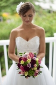 The Bride holds her bouquet in front of her as she prepares for her wedding day.
