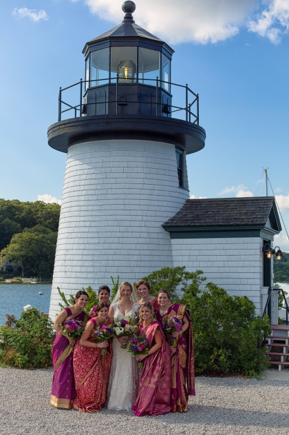 The bride and her bridesmaids pose under the lighthouse of Mystic Seaport, Mystic CT.