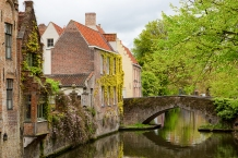 Canals like these line the medieval buildings all over Bruges, Belgium