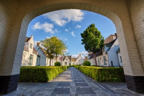 An afforadable housing commune in local Bruges, Belgium. Standing underneath the brick archway and utilizing the lines in the stone walkway to lead the viewer's eyes into the commune, I was able to create this beautiful photograph.