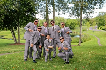 The groomsmen having some fun during their photo shoot at The Barns at Wesleyan Hills